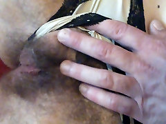 Playing with her open hairy pussy and asian tiny big cock on belly