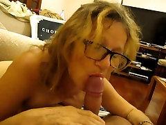 MILF with glasses sucks cock.