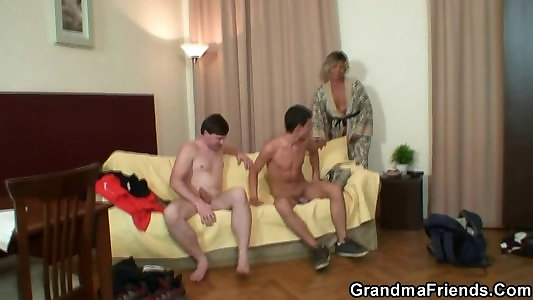 Two youthful boys pound older superslut