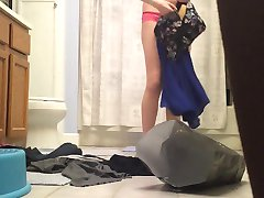 Cute blonde changing her dress in the bathroom