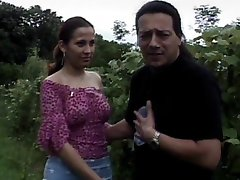 Latin chick blows cock in the bushes