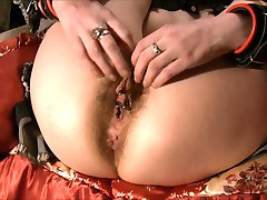 Restrained Hairy gets her clit pumped.