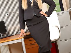 Sophia K entertains her colleagues by stripping out of her tight black skirt suit and showing...