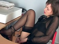 Gorgeous secretary toying in stockings and heels