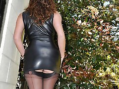 Leggy Milf Nylon Jane is outdoors posing in sexy black latex and silky nylon stockings