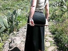 Outdoor caning - deep welts on curvaceous arse
