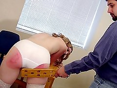 Blonde student paddled on the table by her professor