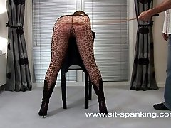 Lovely girl brutally caned to tears - pantyhose pulled down - large sexy ass revealed