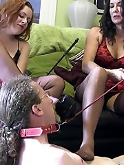 Mistresses trample and smother sissy slave with their high heels and nylon feet, as they use him...