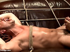 Adam Knox is a shy stud coming in for a standard photo shoot. When he sees some ropes lying...