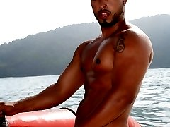 Big muscled bronzed twink Matheus stripping white briefs and teasing with his sexy ass on a boat