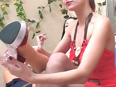 Pantyhosed lesbian chicks playing foot games with their high heel shoes on