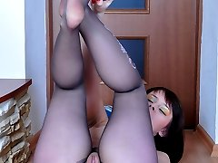 Cute flasher using a glass toy to play with her nyloned feet and stuff pink