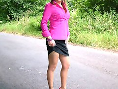 Blonde with an ankle tattoo showing of her pink high heels and sexy nylons