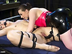 Tough electroslut Dylan Ryan is in a predicament inside Chanel Preston's lesbian electro-dungeon! If Dylan puts her foot down, the plug inside her pussy will shock her. Dylan struggles to maintain her balance while Chanel flogs her and uses the violet wand all over her gorgeous body. Next, Dylan is bound and gagged with e-stim sticky pads on her legs and abs. Chanel torments Dylan with pleasure and pain, and fucks her to multiple orgasms with an electrified dildo. More orgasms ensue as Dylan licks Chanel's pussy, and gets finger-banged while wearing an electric butt plug. Chanel continues to crank the electricity up as Dylan comes over and over again!