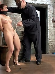 Welcome back Sgt Major and welcome Serena Blair! First up Sgt man handles this slut who looks like she came straight from the mall by binding her progressively into a tight hogtie and shoving a nice thick dildo into her ass. Second Serena is made to walk a brutal and really uncomfortable crotch rope. The Sgt torments her with clothespins, using the cane as incentive to move her ass across the room and finishes her on the floor, turning Serena into a puddle of cum slut. Third this bitch gets subjected to a very intense hogtie suspension. Finally she is bound on the floor spread eagle. Sgt Major slides a nice butt plug into her ass, adds a crotch rope, more clothes pins, and challenges this slut by double penetrating her pussy and ass at the same time.