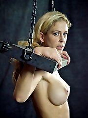 Cherie DeVille starts off in a box, a full sized cage, actually, and while it is uncomfortable...
