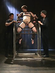Captured and caged, Scotty Zee has no idea what sexy torment awaits him in this dark workshop....