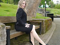 Saucy blonde Kylie is outdoors teasing her nylon legs and shiny black high heel shoes