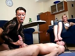 Eager slave licks his mistresss toes while getting a nice handjob from her raunchy blonde kitty...