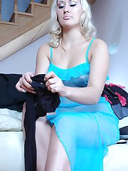 Captivating blondie does not mind wearing her black crotchless pantyhose