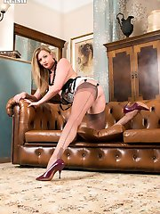 Here is Holly on behalf of the Wanking Instruction Agency in Fully fashioned nylons and open bottom corselette.