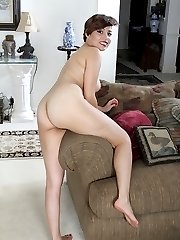Natural beauty Natalie Odom spreads her hairy pussy.