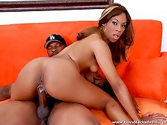 Sexy black sista rides a big dong in a couch