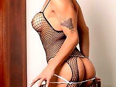 TS Shandira poses in body stockings