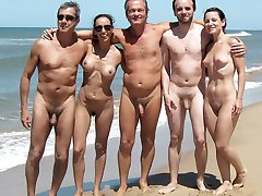 Nudists companies and pair naked on the beach