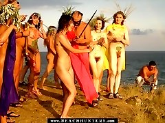 Tanned sexy cuties shot on wild beach celebrations