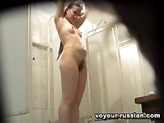 Long-haired blondebeauty filmed fully naked and wet by a shower room camera