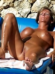 Spread legs on a nude beach