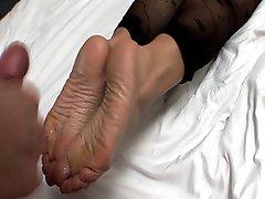 blonde making hot footjob in nylons