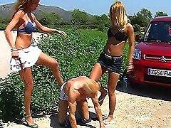Nikki & Carmen outdoor peeing on slave