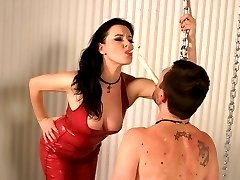 Femdom scene with Mistress Anastasia Pierce inflicting pain to her malesub by dripping hot wax over his back