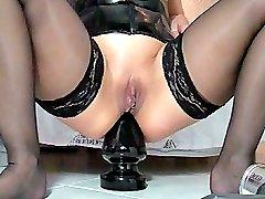 Extreme amateur slut impales herself on a giant butt plug