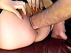 Latex clad slut double fisted up her twat