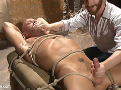 Sebastian Keys just got a job working as a farmhand under a lean country stud, Coby Mitchell. As they move bales of hay into the barn, Sebastian discovers a pile of rope and decides to introduce Coby to bondage and edging. Coby, curious and turned on by the new farmhand, agrees to let Sebastian tie him up. With arms stretched across a horizontal beam, Coby gets his first lesson in edging-- you're not in control. Sebastian blindfolds Coby to heighten the sensation of touch and tears the clothing from his tight body. Coby is already rock hard as Sebastian cuts away his underwear and starts jacking him off. Sebastian brings out his trusted hitachis, running them over Coby's cock head as Coby thrusts his body into them, trying to get himself to cum. The bound cowboy gets tickled and edged once more before Sebastian leaves him on the beam to wait for the next phase of the lesson. Next, Coby's bound to a hay bale, Sebastian continuing to play with the stud's painfully sensitive cock. Sucking on Coby's toes and feet Sebastian works out another edge on the stud. Sebastian moves onto Coby's tight hole, introducing it to dildos and prostate massagers, all the while Coby begs to cum under the treatment. After an entire afternoon of edging, Sebastian feels generous enough to conclude the lesson and has Coby bust a thick load and even shoots himself in the face!