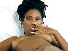 Ebony whore seductively posing to reveal her juicy fur burger!