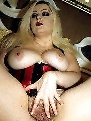 Busty blonde Zenova Braeden brandishes her big boobs while rubbing her hirsute pussy