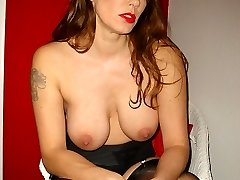 Goregeous Cougar Nylon Jane taunts her big juicy tits in sexy nylons, lingerie and high heels