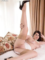 Newcomer, Kylie is presented in vintage nylon slip, girdled hips and tan nylons.