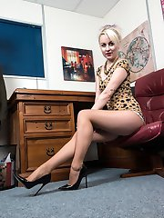 Kiana get to fix a piece of equipment in the office, in her super short mini dress with lots of pantyhosed leg and upskirt!