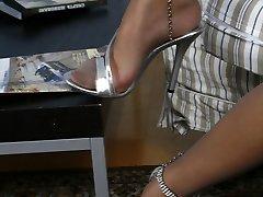 Slim platinum blonde unwraps to suntan pantyhose demonstrating her eatable feet