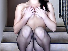 Sexy raven-head flashes on the stairs in her exclusive back seam pantyhose