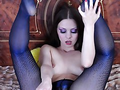 Nasty hussy expertly rubs a rubber cock with her sleek feet in fashion hose