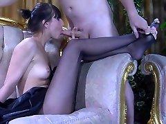 Slender-legged nymph in dark sandal toe pantyhose gives a special nylon footjob