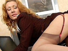 Two chicks in business suits flash stockinged legs while having box lunch