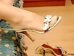 Fabulous chick pedicures her sugary-sweet feet before putting on her nylon tights